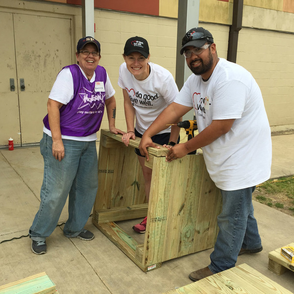 Volunteers construct a waste bin at South Houston Elementary playground