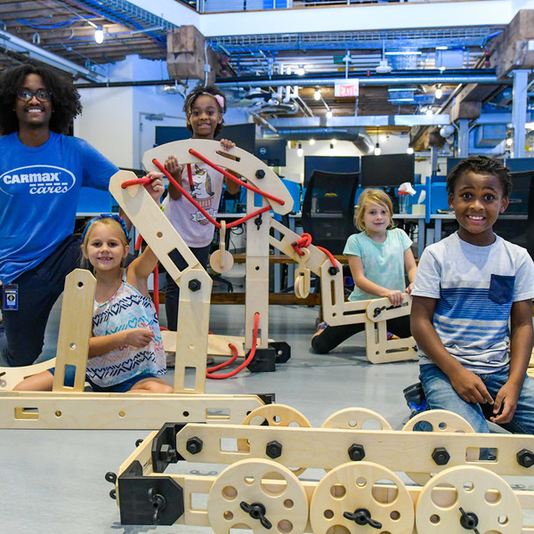 CarMax Foundation Future Innovators kids pose with Rigamajig