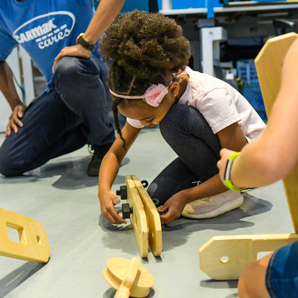 CarMax Foundation Future Innovators young girls screws together Rigamajig planks