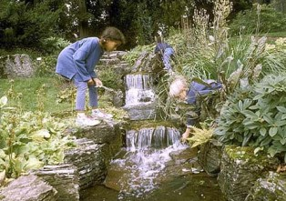 Children play with water outside