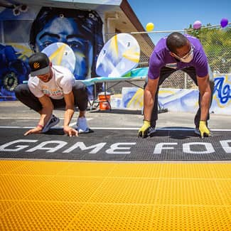 Stephen Curry and Ayehsa Curry put in the final piece of the multi-sport court with KABOOM!
