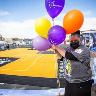 Volunteer holds balloons